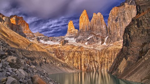 4K sunrise in Torres del Paine Patagonian mountains and lake with moving clouds, Chile - time lapse