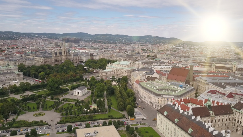 Aerial view of Vienna in the rays of the setting sun. Heldenplatz, Rathaus, Volksarden and university of Vienna skyline aerial shot. Cathedrals and cityscape City of Vienna, Austria. | Shutterstock HD Video #1039602494