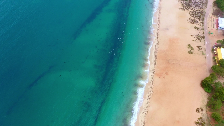 Amazing sandy beach and deep blue ocean water from above - aerial drone footage | Shutterstock HD Video #1039637174