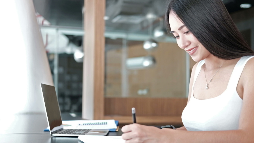 Businesswoman working studying writing note at workplace. startup woman entrepreneur looking at watch checking time at office. | Shutterstock HD Video #1039797614