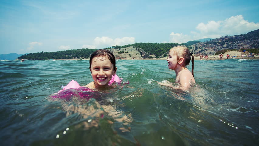 Stock video clip of two little girls on vacation swimming - Swimming pool girl christmas vacation ...