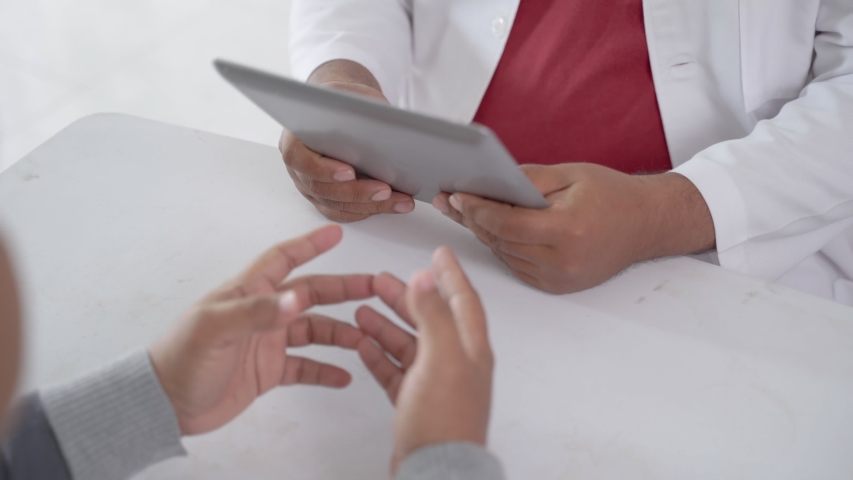 Portrait of smiling doctor shaking hand with patient in his office | Shutterstock HD Video #1040024714