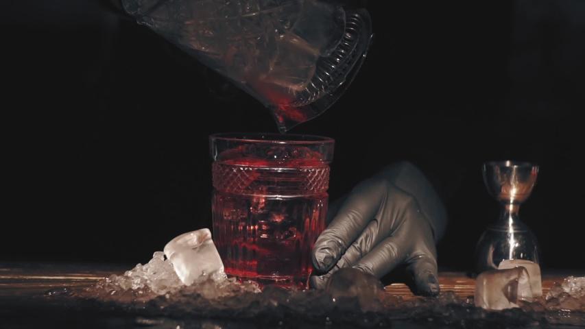 Bartender make a cocktail at bar | Shutterstock HD Video #1040060924