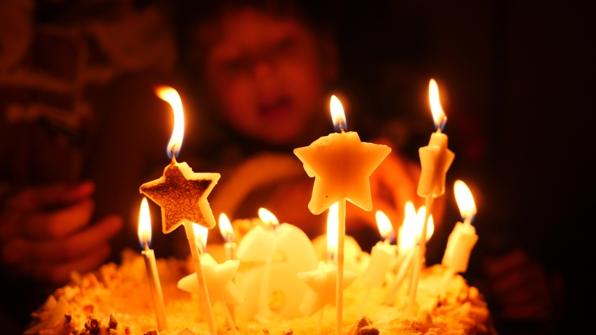 Preparing birthday cake for child lighting up candles before kid boy blow out them #1040252354