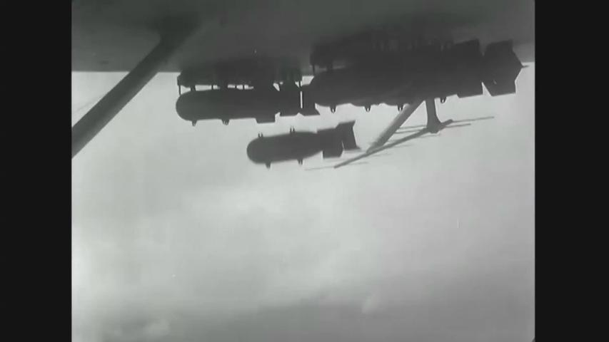 CIRCA 1940s - Bombs being dropped and a gunner firing 50 cal machine gun from a US bomber plane, World War II 1942