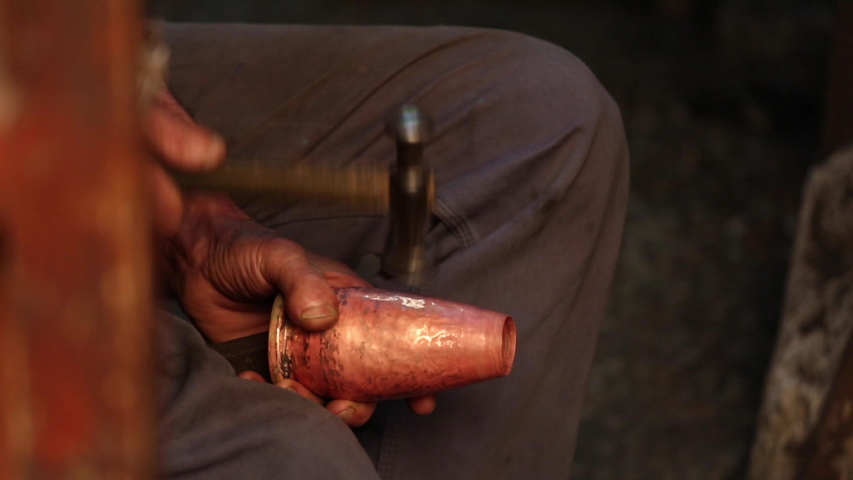 Old man uses hammer to prepare copper | Shutterstock HD Video #1040494544