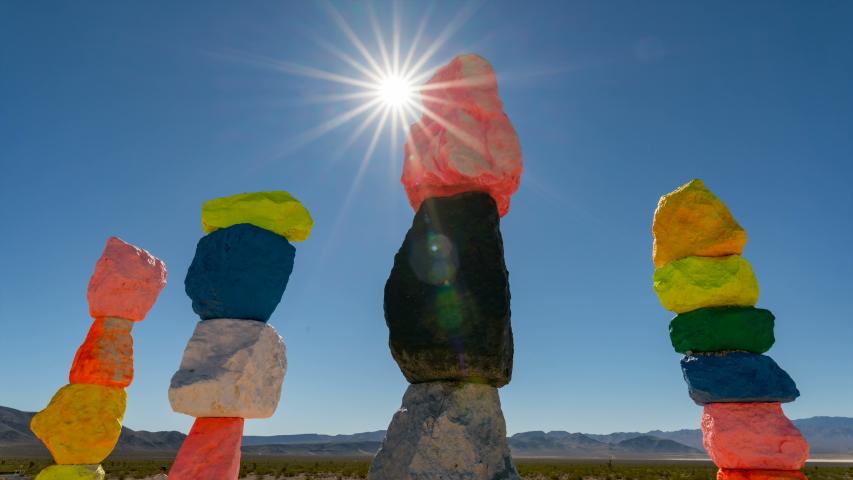 Timelapse of sun rays over Seven Magic Mountains in Mojave Desert, Nevada