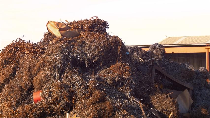 Steel junk yard metal waste | Shutterstock HD Video #1040684384