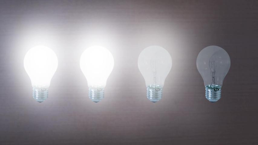Four light bulbs light up   Shutterstock HD Video #1040846864
