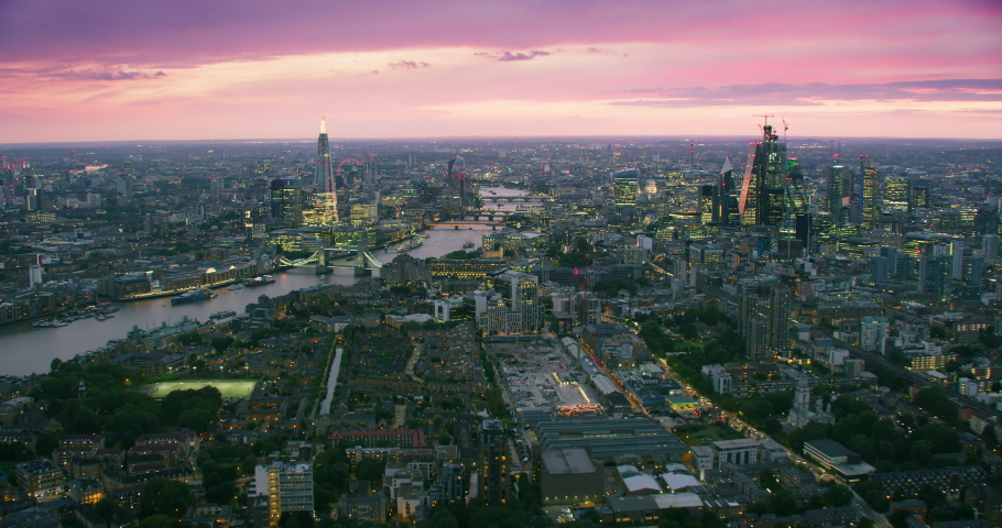 Aerial view of London's famous landmarks.The city financial district with its modern skyscrapers. Famous bridges and buildings. Thames River. England. UK. | Shutterstock HD Video #1040869244