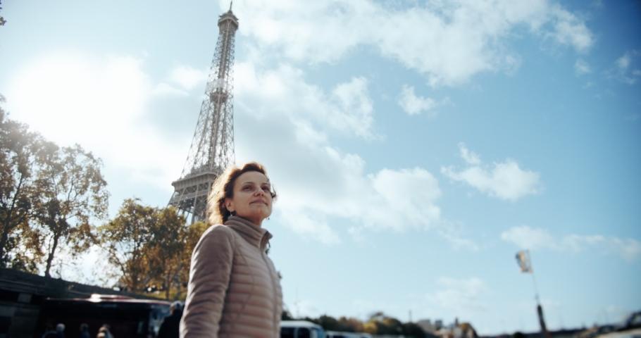POV view travel concept. Young couple holding hands woman leading boyfriend walking towards near Eiffel Tower Paris | Shutterstock HD Video #1040971844