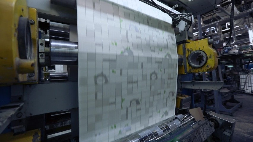 The process of producing wallpaper, printing on wallpaper, conveyor at the factory for the production of wallpaper. Modern factory | Shutterstock HD Video #1040981474