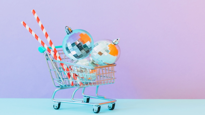 Minimal Motion art. Christmas shopping in supermarket cart with flying сhristmas ball. Seamless effect   Shutterstock HD Video #1041091444