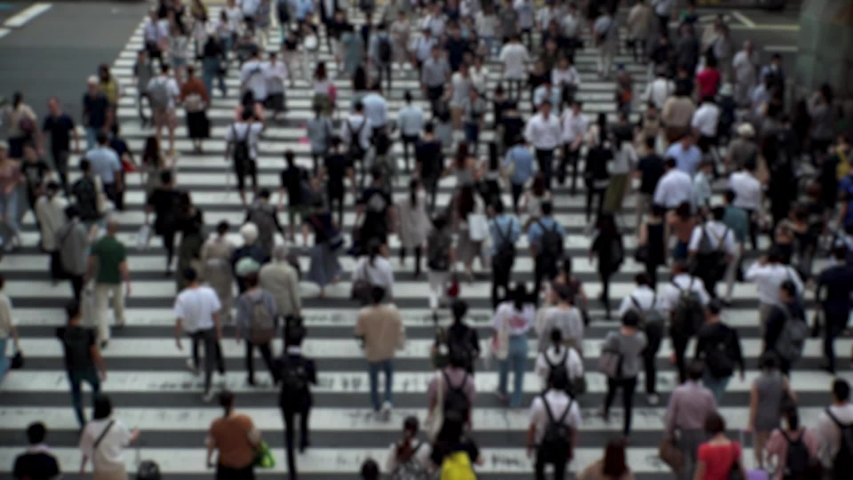 UMEDA, OSAKA, JAPAN - CIRCA SEPTEMBER 2019 : Aerial blurred high angle view of zebra crossing near Osaka train station. Crowd of people at the street. Shot in busy rush hour. Wide slow motion. | Shutterstock HD Video #1041098734