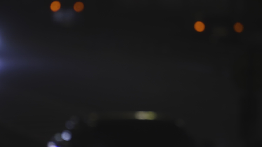 Defocused Night City Traffic Lights. Color Blurred bokeh of moving transport and typical city noise. | Shutterstock HD Video #1041162484