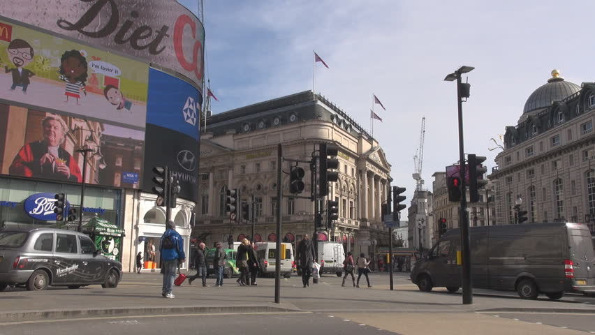 London England United Kingdom  London Piccadilly Circus Square Sunny Day Car Traffic Double Decker Billboards