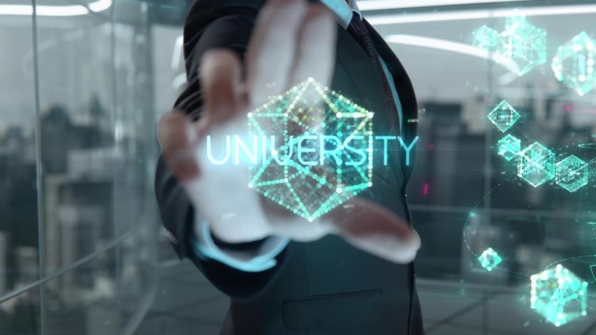 Businessman with University hologram concept   Shutterstock HD Video #1041460534