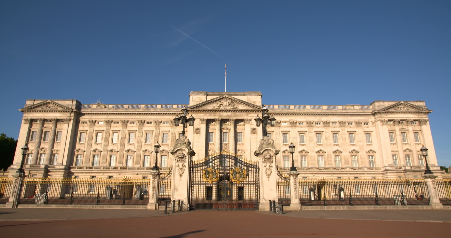 Front of Buckingham Palace in London, The Queen's official London residence home and a working royal palace feat. Union Jack flag flying over Buckingham Palace. 4K, empty, No people slow motion video  | Shutterstock HD Video #1041545344