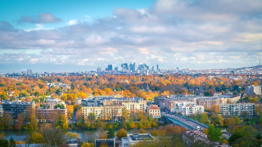 Zoom in to skyscrapers of Paris business district La Defense. Timelapse at a sunny autumn day with blue cloudy sky. From Saint-Germain-en-Laye, west of Paris, France | Shutterstock HD Video #1041692824