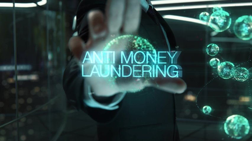 Businessman with Anti Money Laundering hologram concept | Shutterstock HD Video #1041755944