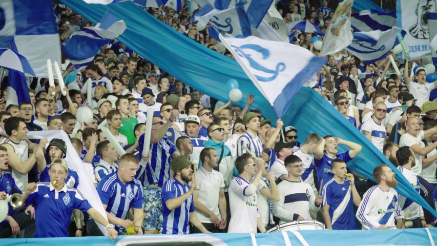 KYIV, UKRAINE – MAY 20, 2018. Fans in the stadium during the game. Olimpiyskiy. Kyiv. Ukraine.   Shutterstock HD Video #1041804634