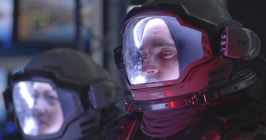 Medium close-up of a young male astronaut experiencing pain during rocket launch | Shutterstock HD Video #1041809974