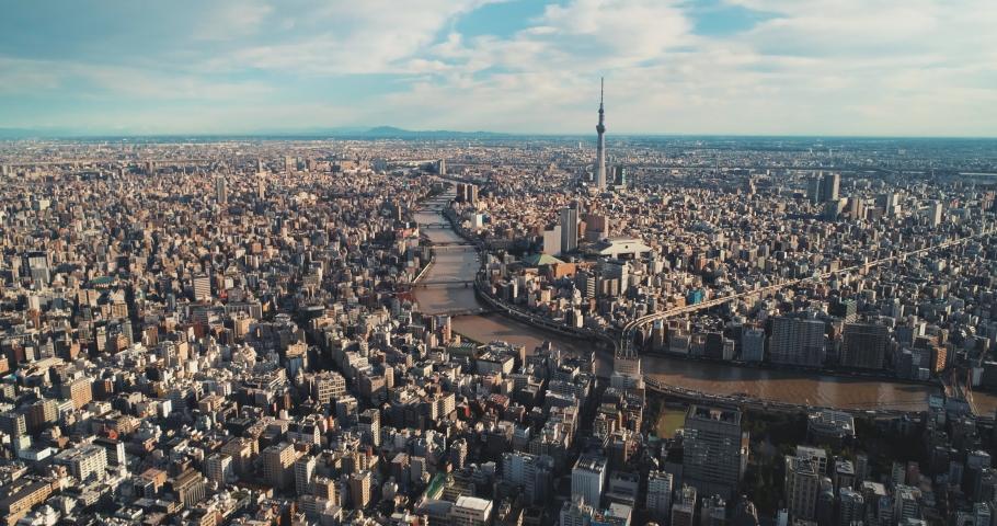 Aerial shot of Skytree and Ryogoku Kokugikan with Edo-Tokyo Museum in Tokyo city, Japan | Shutterstock HD Video #1041914914