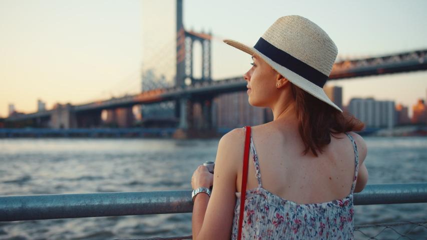 Attractive tourist with a retro camera at the Manhattan bridge | Shutterstock HD Video #1042247974