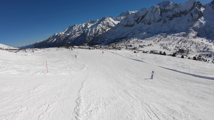 Ponte di Legno, Tonale, Italy. Skiing on the slopes in a wonderful day. POV from the skier. Point of view from the ski helmet. Italian Alps | Shutterstock HD Video #1042302154