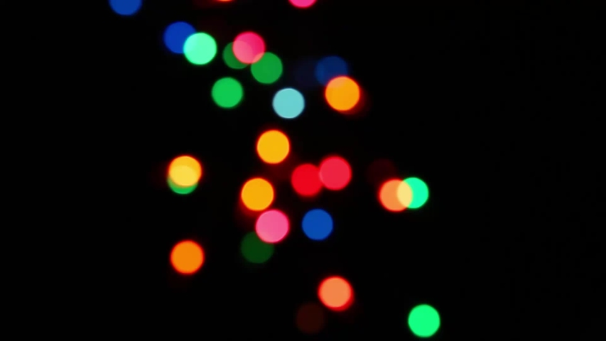 Lights bokeh sparkle background presents for holiday celebration. Copy space. | Shutterstock HD Video #1042320124