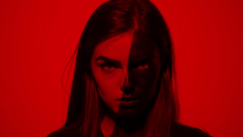 Attractive young woman half face girl drawn in black look at camera serious red light background flashing colored light abstract art beauty artistic creative decoration design fashion slow motion | Shutterstock HD Video #1042456204