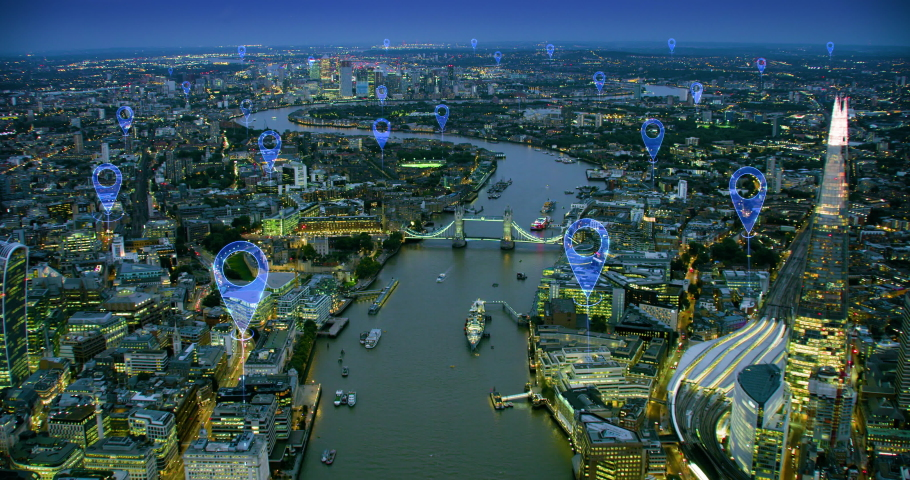 Aerial futuristic view of London skyline. Localization icons in a connected city. Technology concept, data communication, artificial intelligence, internet of things, smart city. Blue icons. England. | Shutterstock HD Video #1042556584