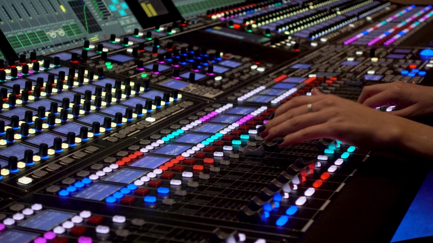 Close-up of a mixing console, the hand adjusts the faders Professional recording studio. | Shutterstock HD Video #1042569514