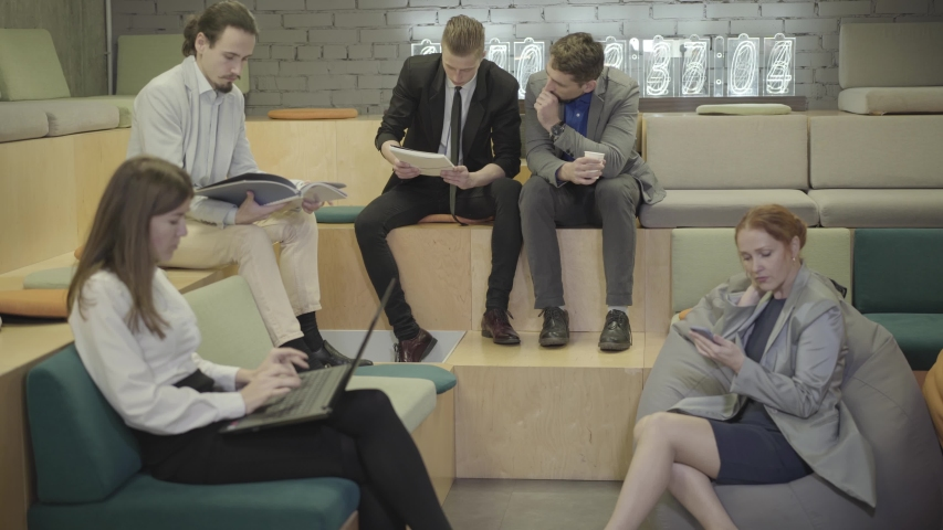 Caucasian office workers working in creative open space. Five young men and women thinking on their project. Modern lifestyle, coworking, office, business, creativity. | Shutterstock HD Video #1042585114