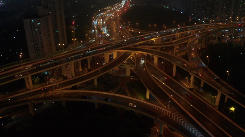 Rising shot shot the huge spectacular elevated highway and  roads, bridges, traffic in Shanghai at night, transportation and infrastructure development in urban China | Shutterstock HD Video #1042594654