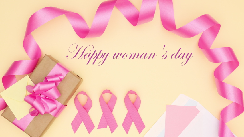 Happy woman's day title appear with pink decoration for women and girls on yellow background - Stop motion  | Shutterstock HD Video #1042647634