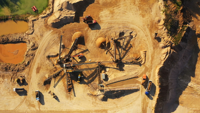 4K. Aerial view of a large Sand Quarry in working process with heavy machinery: sorting conveyor, bulldozers, excavators and trucks.  | Shutterstock HD Video #1042692574