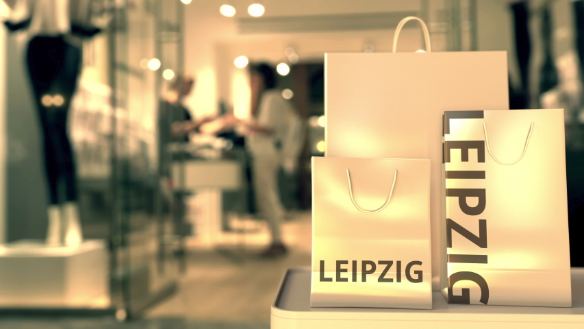 Paper bags with Leipzig text. Shopping in Germany related conceptual 3D animation | Shutterstock HD Video #1042715404