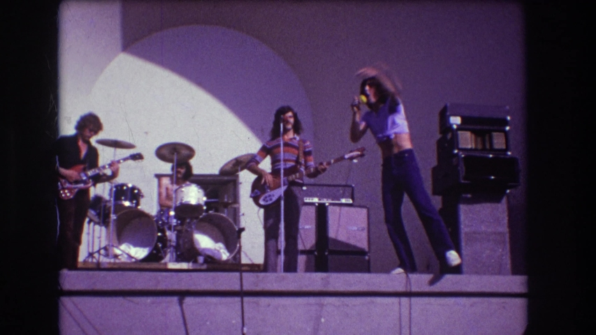 MEDFORD NEW JERSEY USA-1973: A Rock And Roll Band Performing Live, The Person Is Singing On The Edge Of The Stage | Shutterstock HD Video #1042734964
