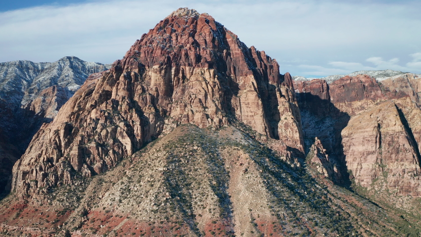 Aerial orbit shot of Rainbow Wall in Red Rock Canyon National Conservation Area | Shutterstock HD Video #1043029054