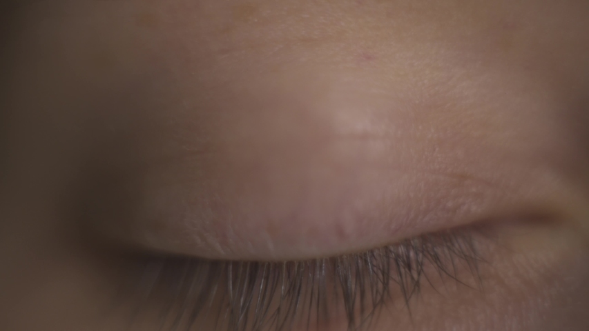 Macro close-up brown woman's eye. Woman opens eye, moving eyeball, watching in different directions, look up, down, right, left. Human eye, eyelash, eyelid, brown iris, face. Natural beauty. | Shutterstock HD Video #1043482114