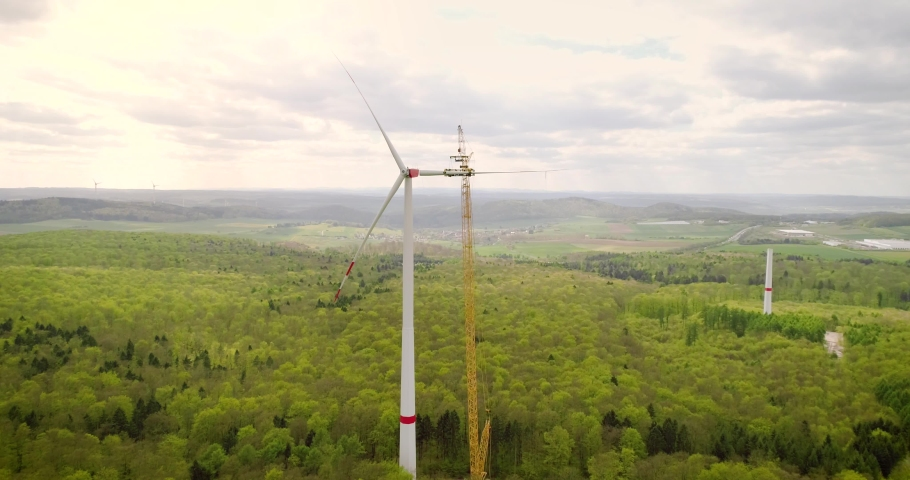 Aerial view of wind turbine under construction | Shutterstock HD Video #1043598274