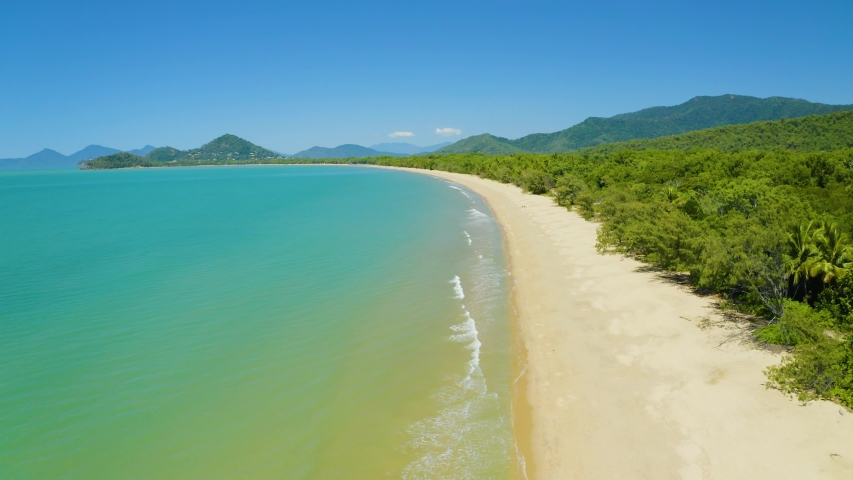 Aerial, beautiful view on huge sand beach and a coastline in Palm Cove, Cairns in Queensland, Australia | Shutterstock HD Video #1044094114