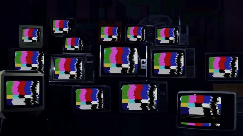 Row Of Retro TVs turning On Color Bars on their Screens. | Shutterstock HD Video #1044370774