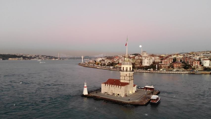 4K - Aerial drone view of Maidens Tower (Kiz Kulesi), Moon and beautiful Bosphorus in the background. | Shutterstock HD Video #1044450484
