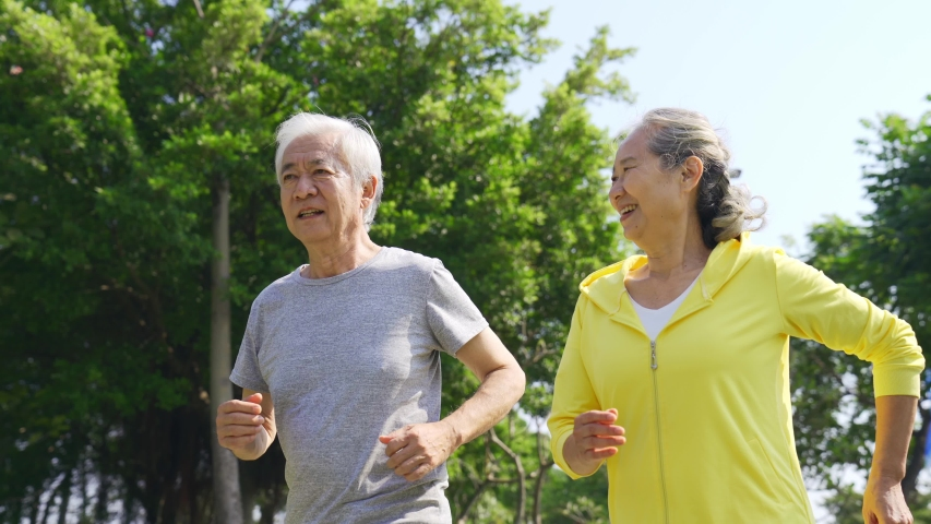 Happy senior asian couple exercising running outdoors | Shutterstock HD Video #1044545014