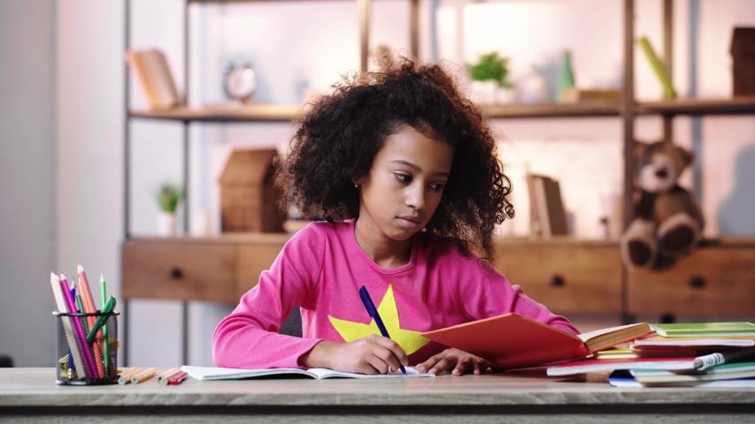 African american child doing homework | Shutterstock HD Video #1044775564