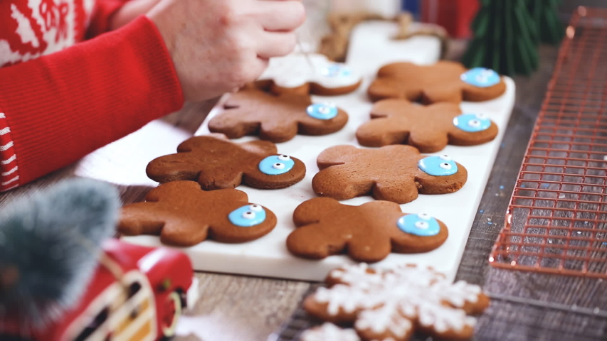 Step by step. Decorating gingerbread cookies with royal icing.   Shutterstock HD Video #1044885364