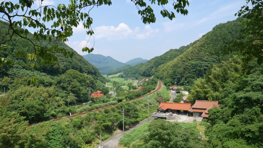 View of rural village beside a railway in Japan. without sounds | Shutterstock HD Video #1044913324