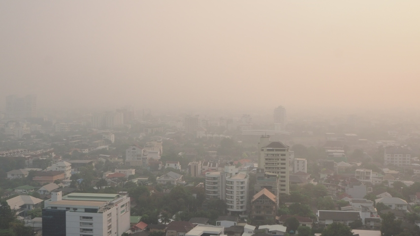 Cityscape of Bangkok covered by mixture of dust in air pollution, situation of air pollution 2.5 pm in Bangkok, Air pollution in big city,  it is unhealthy. | Shutterstock HD Video #1044994564